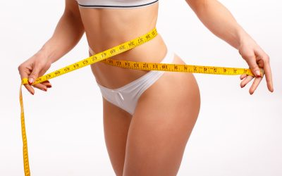 Perfect women body measuring waist. Isolation on white
